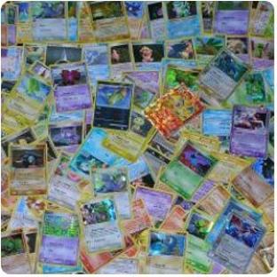 100 Assorted Pokemon Cards with Foils and Bonus Mew Promo
